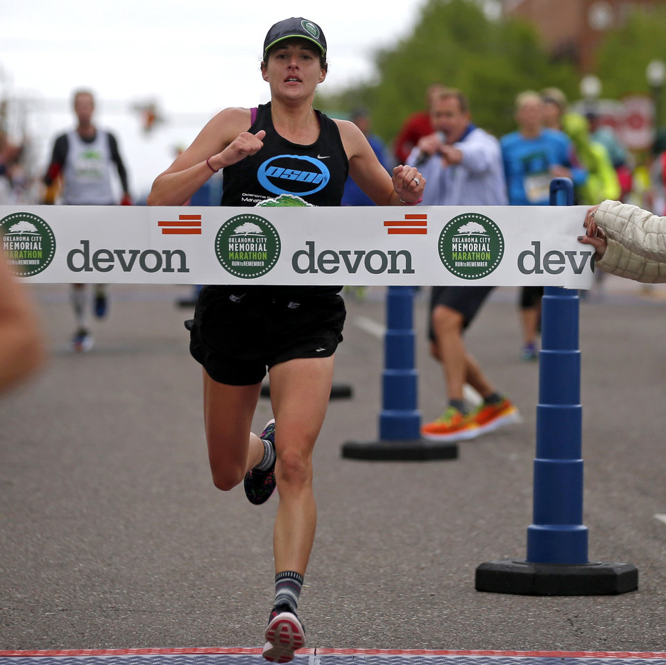 Photo - Cat Lisle wins the women's division of the Oklahoma City Memorial Marathon in Oklahoma City, Sunday, April 30, 2017. Photo by Bryan Terry, The Oklahoman