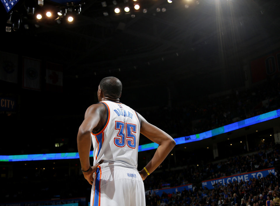 Photo - Oklahoma City's Kevin Durant (35) during an NBA basketball game between the Oklahoma City Thunder and the Orlando Magic at Chesapeake Energy Arena in Oklahoma City, Wednesday, Feb. 3, 2016. Photo by Bryan Terry, The Oklahoman