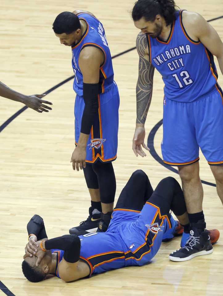 Photo - Oklahoma City's Steven Adams and Andre Roberson (21) help Oklahoma City's Russell Westbrook (0) after an injury during Game 2 in the first round of the NBA playoffs between the Oklahoma City Thunder and the Houston Rockets in Houston, Texas,  Wednesday, April 19, 2017.  Photo by Sarah Phipps, The Oklahoman