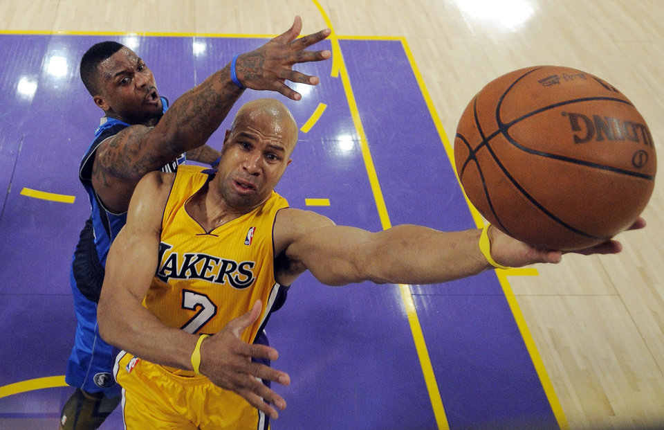 Photo - Los Angeles Lakers guard Derek Fisher, right, puts up a shot as Dallas Mavericks guard DeShawn Stevenson defends during the second half in Game 2 of a second-round NBA playoff basketball series, Wednesday, May 4, 2011, in Los Angeles. The Mavericks won 93-81. (AP Photo/Mark J. Terrill)