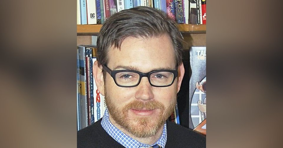 OU professor Jeremy Short is seen with his graphic novel