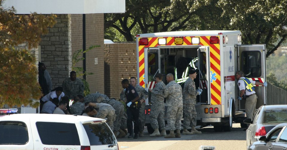 Wounded soldiers are prepared for transport Nov. 5, 2009, in waiting ambulances outside Fort Hood's Soldier Readiness Processing Center in Fort Hood, Texas. Public works officials announced plans Tuesday to raze the structure that's part of the Soldier Readiness Processing Center. AP FILE PHOTO