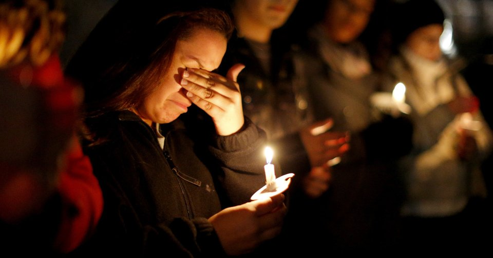 Chellie Fernandez becomes emotional as she speaks during the vigil Tuesday at OU.