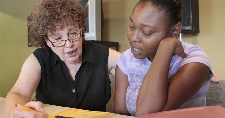 Instructor Kay Walls works with Tina Roberts, a student in a TANF basic skills class in literacy and math through Community Literacy Centers and DHS, at Britton Christian Church. Photo By David McDaniel, The Oklahoman  David McDaniel