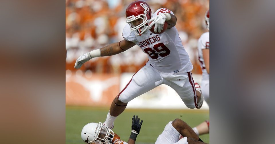 Oklahoma\'s Austin Haywood (89) leaps over Texas\' Carrington Byndom (23) during the Red River Rivalry college football game between the University of Oklahoma Sooners (OU) and the University of Texas Longhorns (UT) at the Cotton Bowl in Dallas, Saturday, Oct. 8, 2011. Oklahoma won 55-17. Photo by Bryan Terry, The Oklahoman