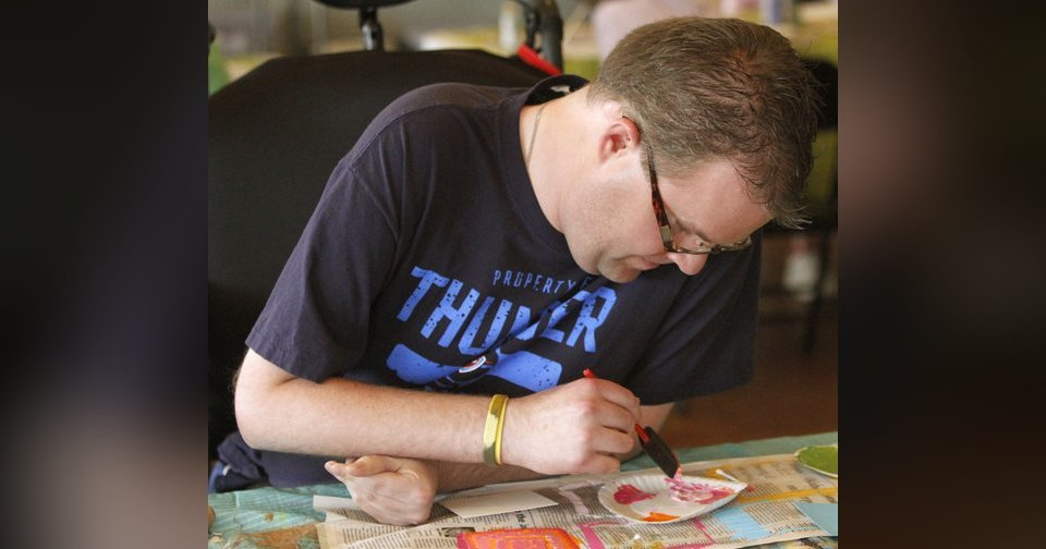 Richie Lumpkin paints during an arts and crafts class at Wings in Edmond. Photos By Steve Gooch, The Oklahoman