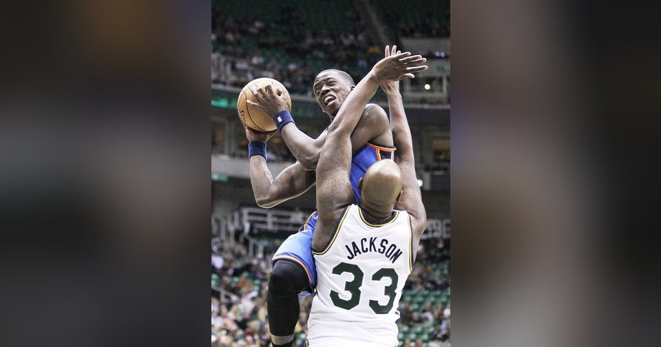 Thunder guard Reggie Jackson, top, drives to the basket as Jazz forward Darnell Jackson defends in the second quarter during a preseason game on Friday. AP Photo