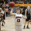 Photo -  Norman's Lainy Fredrickson takes a shot at the end of Friday's game against Norman North at Norman High School. [PHOTO BY BRYAN TERRY, THE OKLAHOMAN]