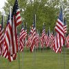Staff, students plant flags to honor victims of...
