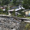 Japan braces for more heavy rain as death toll...