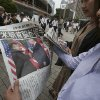 "People look at an extra edition of the newspaper Yomiuri reporting about the summit between U.S. President Donald Trump and North Korean leader Kim Jong Un in Singapore, at Shimbashi Station in Tokyo, Tuesday, June 12, 2018. President Trump and North Korea's Kim came together for a momentous summit Tuesday that could determine historic peace or raise the specter of a growing nuclear threat, with Trump pledging that ""working together we will get it taken care of."" (AP Photo/Koji Sasahara)"