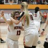 Photo -  Norman's Lainy Fredrickson, left, celebrates with teammate Brennan Hockett and Turner Mattingly after making a basket at the end of a game against Norman North Friday at Norman High School.[PHOTO BY BRYAN TERRY, THE OKLAHOMAN]