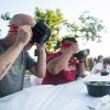 Competitors John Degerness, left, and Tommy Nguyen compete in the pho eating contest at the first Asian Night Market Saturday, June 9, 2018. Pho is a traditional Vietnamese soup that includes broth, rice noodles and meat, in this case beef. Nguyen won the competition, which lasted for 10 minutes. Photo by Anya Magnuson, The Oklahoman