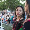 Thiana Hnem looks back at another girl participating in the fashion show before they walk onto the state at the first Asian Night Market Saturday, June 9, 2018. The fashion show is called Asia's Beauty, and the festival's purpose is created for people with Asian heritage to honor their roots and educate the community about the various cultures within the Asian community. Photo by Anya Magnuson, The Oklahoman