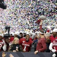 Oklahoma coach Lincoln Riley hoists the Big 12 championship trophy after beating Baylor 30-23 in overtime Saturday. [Bryan Terry/The Oklahoman]