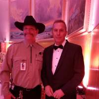From left, Tim, the head of security and new social media star for the National Cowboy & Western Heritage Museum, and Kevin Costner pose for a...