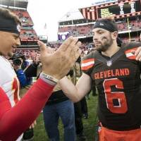 Chiefs quarterback Patrick Mahomes (15) and Browns quarterback Baker Mayfield (6) shake hands after a game in 2018 in Cleveland. [Ken Blaze/USA...