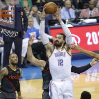 Oklahoma City's Steven Adams (12) goes to the basket during Game 4 in the first round of the NBA playoffs between the Portland Trail Blazers and...