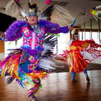 Fancy dancers Cecil Gray and Courtney Reeder perform during a Red Earth press conference at the Petroleum Club in Oklahoma City, Okla. on Monday,...