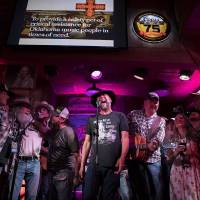 John Cooper, a member of the Payne County band Red Dirt Rangers as well as of the all-volunteer board of the Red Dirt Relief Fund, performs at...
