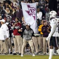 Texas A&M coach Jimbo Fisher yells to his players during the second half of a game against South Carolina in November. The Aggies will play...