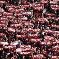 "OU fans hold up ""Boomer"" signs during the 2018 Bedlam game. [Bryan Terry/The Oklahoman]"
