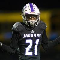 OU commit Latrell McCutchin celebrates a touchdown during a high school football game between LBJ and McCallum in Austin, Texas, on Sept. 21,...
