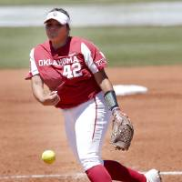 Oklahoma's Mariah Lopez (42) throws a pitch in the second inning during college softball game between Oklahoma and Wisconsin in the NCAA Norman...