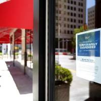 A sign about a temporary closure is posted Saturday on the doors of Skirvin Hilton in Oklahoma City. [Sarah Phipps/The Oklahoman]