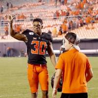 Oklahoma State's Chuba Hubbard acknowledges the fans following the Kansas State game at Boone Pickens Stadium in September. Hubbard is the...