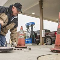 Justin Lankford, an Oklahoma Corporation Commission fuel specialist, conducts an inspection of the gas pumps at a Murphy USA fuel station in...