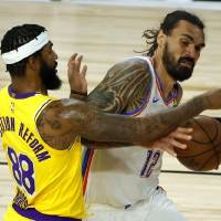 Steven Adams (12) fights off Markieff Morris during the second quarter of the Thunder's win over the Lakers on Wednesday in Lake Buena Vista, Fla....