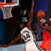 August 7, 2020; Lake Buena Vista, Florida, USA; Oklahoma City Thunder guard Luguentz Dort (5) shoots as Memphis Grizzlies forward Anthony Tolliver...