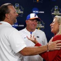 OSU coach Kenny Gajewski, Florida coach Tim Walton and OU coach Patty Gasso talk following a press conference before the Women's College World...