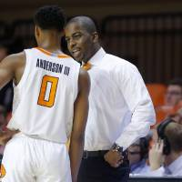 Oklahoma State coach Mike Boynton talks with Oklahoma State's Avery Anderson III (0) during an NCAA basketball game between the Oklahoma State...