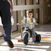 Photo - Riding his trike, Troy Yoder, 3, follows his dad Monday down a hallway in the pediatric intensive care unit at Integris Baptist Medical Center. Photos by Jim Beckel, The Oklahoman