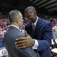 Billy Donovan, left, and Anthony Grant talk before coaching against each other Jan. 23, 2014 in Tuscaloosa, Ala. Donovan's Florida Gators beat...