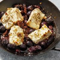 Roasted Feta With Grapes and Olives. [Tom McCorkle/for The Washington Post]