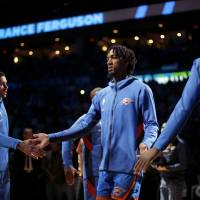 Oklahoma City's Terrance Ferguson is introduced before an NBA basketball game between the Oklahoma City Thunder and the New Orleans Pelicans at...