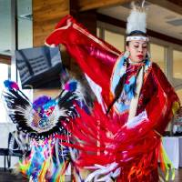 Native American dancers Courtney Reeder and Cecil Gray perform during a Red Earth press conference at the Petroleum Club in Oklahoma City, Okla. on...