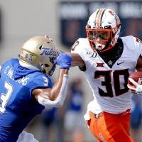 Oklahoma State's Chuba Hubbard, right, was named the Big 12 Offensive Player of the Week after rushing for 256 yards and three touchdowns at Tulsa...