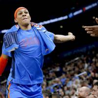 Oklahoma City's Darius Bazley (7) reacts on the bench during the NBA basketball game between the Oklahoma City Thunder and the Portland Trail...