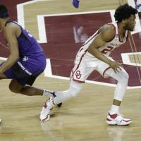 Oklahoma's Elijah Harkless (24) leaves TCU's Kevin Easley Jr. (34) in the wrong direction in the second half of an 82-46 win Tuesday in Norman....