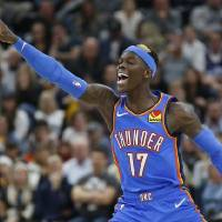 Oklahoma City Thunder guard Dennis Schroder (17) reacts after scoring against the Utah Jazz in the second half during an NBA basketball game...