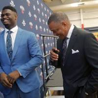 Pelicans first-round draft pick Zion Williamson, left, laughs with coach Alvin Gentry after his introductory news conference Friday in Metairie,...