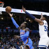 Oklahoma City's Dennis Schroder (17) shoots in front of Minnesota's Kelan Martin (30) in the first quarter during an NBA basketball game between...