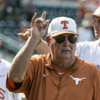"Texas coach Augie Garrido sings ""The Eyes of Texas"" with the team after Texas defeated Baylor 7-6 in a college baseball game in Austin, Texas, on Saturday, May 21, 2016. (Rodolfo Gonzalez/Austin American-Statesman via AP)"