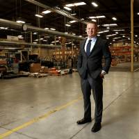 Zach Martin, a partner in Adept Commercial Real Estate, is shown in improved warehouse space at 16 S Pennsylvania Ave. freshly leased by HurryHub,...