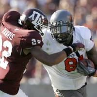Oklahoma State's Justin Blackmon, right, tries get by Texas A&M's Dustin Harris in the last meeting between the Cowboys and Aggies at Kyle...