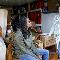 Lynda Steele, founder of Furnishing Fatherhood, right, talks with one of the dads who has benefited from the organization, Allen Shaw, as the two...